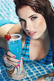 Woman with drink  in  pool Stock Photography
