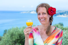 Woman with drink and red rose near sea Royalty Free Stock Photo