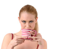 Woman drink tea or coffee Stock Images