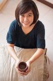 Woman drink tea. Young asian woman drink tea stock photos