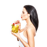 Woman drink tropical cocktail in pineapple with straw Royalty Free Stock Photo