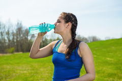 Woman drink water . Beautiful young woman drink water after fitness workout royalty free stock image