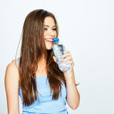 Woman drink water from blue bottle . Stock Photos