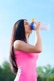 Woman drink water bottle sport on stadium Royalty Free Stock Photography