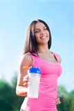 Woman drink water bottle sport on stadium Royalty Free Stock Photos