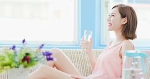 Woman drink water. And feel happily at home royalty free stock photography