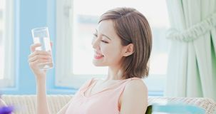 Woman drink water. And feel happily at home royalty free stock images