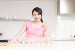 Woman drink water. With health concept in the kitchen royalty free stock photo