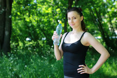 Woman drink water sport stock photography