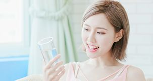 Woman drink water. And feel happily at home stock image