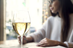 Woman drink white wine near window in restaurant. Or cafe Royalty Free Stock Images