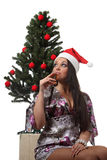 Woman drink a wine in front of a christmas tree Royalty Free Stock Image