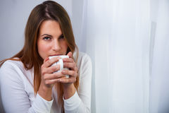 Woman with a drink Stock Photography