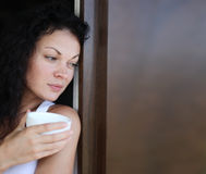 Woman Drinking. Attractive female drinking tea at home Royalty Free Stock Images