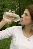 Woman drinking Royalty Free Stock Image