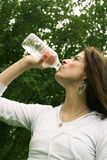 Woman drinking Stock Image