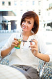 Woman drinking Stock Images