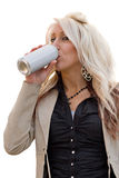 Woman Drinking. A young woman drinking from an aluminum can with a blank label Royalty Free Stock Images