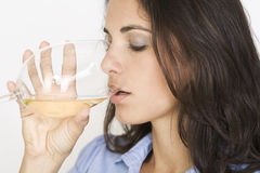 Woman Drinking A Glass Of White Wine Royalty Free Stock Photos