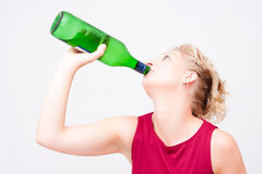 Woman drinking alcohol Royalty Free Stock Images