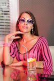 Woman drinking alcohol cocktail. Pretty woman drinking cocktail in nightclub Royalty Free Stock Image