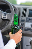 Woman drinking alcohol and driving Royalty Free Stock Images