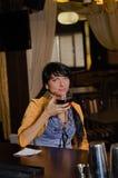 Woman drinking alone at the bar royalty free stock photo