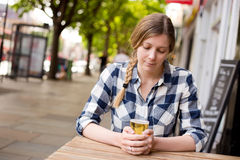 Woman drinking alone Stock Images