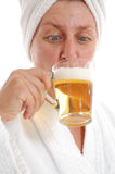 Woman drinking beer Stock Image