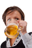 Woman drinking beer Stock Images