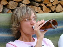 Woman drinking beer royalty free stock images