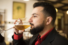 Woman drinking beer in bar Royalty Free Stock Photos