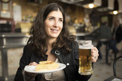 Woman drinking beer in bar Royalty Free Stock Images