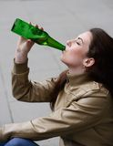 Woman drinking beer Royalty Free Stock Photo