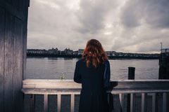 Woman Drinking Beer By The River Royalty Free Stock Photos