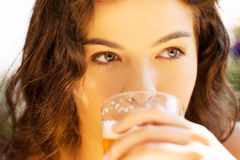 Woman drinking beer on  cafe. Royalty Free Stock Photos