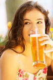 Woman drinking beer on  cafe. Royalty Free Stock Images
