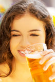 Woman drinking beer on  cafe. Stock Photos