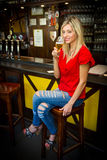 Woman drinking beer at the pub Royalty Free Stock Photo