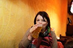 Woman drinking beer Stock Photo