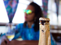 Woman drinking beer. Woman with sunglasses drinking beer in a tropical bar - Brazil Stock Photography