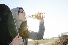 Woman drinking beer Stock Photography