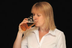 Woman drinking a beverage Royalty Free Stock Photos