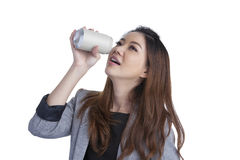 Woman drinking from blank can Stock Images