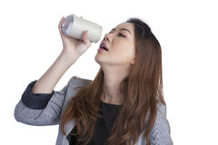 Woman drinking from blank can Royalty Free Stock Images