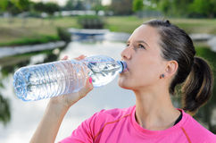 Woman Drinking from Bottle. Sports woman drinking cold water Royalty Free Stock Photo