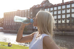 Woman drinking from a bottle. Woman drinking from a botte in summer in Berlin Stock Photos