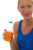 Woman drinking a bottle of energy drink Stock Image