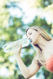 Woman drinking bottled water Royalty Free Stock Images