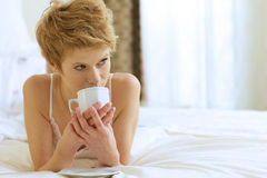 Woman drinking caffee Stock Photo
